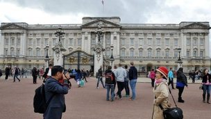 File photo dated 20/10/2014 of tourists taking a photograph outside Buckingham Palace