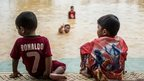 Boys play in Malaysian floodwaters