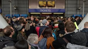Travellers crowded in front of Finsbury Park ticket office