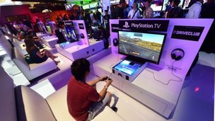 A gamer playing PlayStation