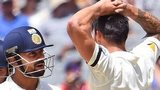 India batsman Virat Kohli (cenre) exchanges words with Australia paceman Mitchell Johnson
