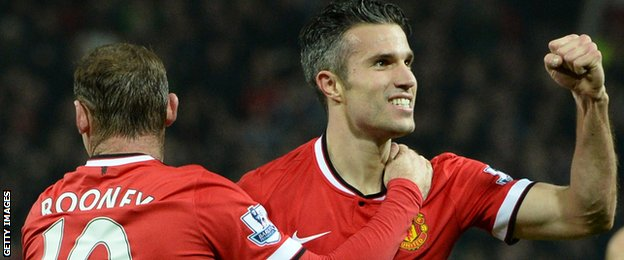 Manchester United's Dutch striker Robin van Persie (R) celebrates scoring their third goal with Manchester United's English striker Wayne Rooney (L) during the English Premier League football against Hull City on 29th Nov 2014.