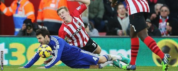 Fabregas went round Targett before falling to the ground in the box