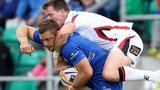 Leinster's Jimmy Gopperth has to take the weight of Ulster wing Craig Gilroy