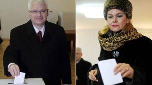 Ivo Josipovic and Kolinda Grabar-Kitarovic cast their votes in Croatia's presidential election