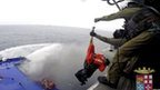 A person is lifted on an Italian Navy helicopter as the car ferry Norman Atlantic burns in waters off Greece