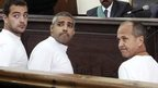 Baher Mohamed, Mohamed Fahmy and Peter Greste in court in Cairo (31 March 2014)