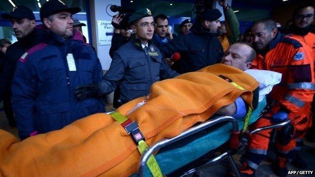 Passenger being taken to hospital