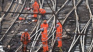 Workers on tracks