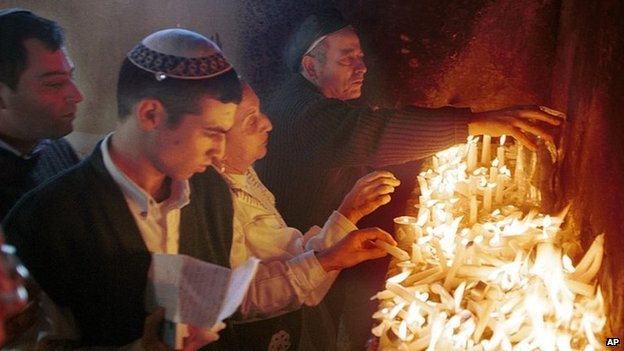 Jewish pilgrims light candles at a shrine dedicated to Rabbi Yaakov Abuhatzeira in Damanhur, Egypt (1999)
