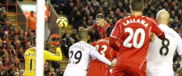 Martin Skrtel heads towards goal