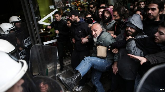 Protesters clash with riot police over the government's decision to relax Sunday shopping laws