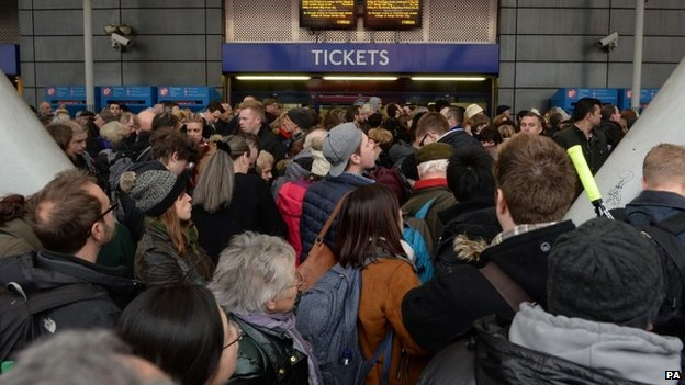 Travellers are locked out of Finsbury Park station, north London, where they were directed to go after trains in and out of King's Cross were cancelled. Saturday 27 December 2014.
