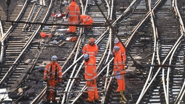 Railway workers on the tracks outside London King's Cross. Saturday 27 December 2014.