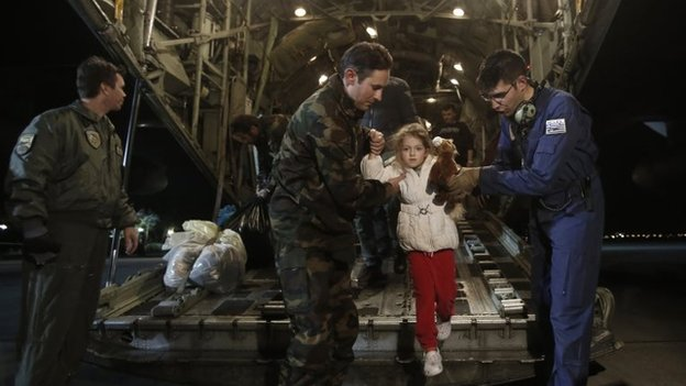 "Rescued passengers of the ""Norman Atlantic"" accident, Marko Gondolo, second left, 40, and his daughter Serafina, 5, arrive from Italy at Elefsina Air Base outside Athens, on Monday, Dec. 29, 2014."