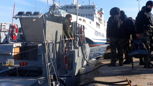 "Armed special missions officers of the Greek coast guard set off from Corfu harbour for waters off the Ionian island of Othoni, responding to a distress signal from Moldovan-registered freighter ""Blue Sky M"" in the area, in Corfu, Greece, 30 December 2014"