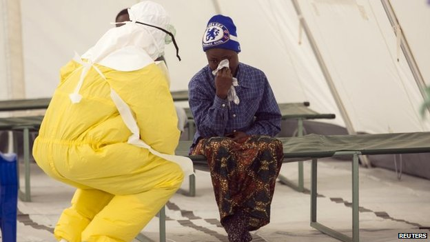 A woman waits to be seen in an Ebola treatment centre.