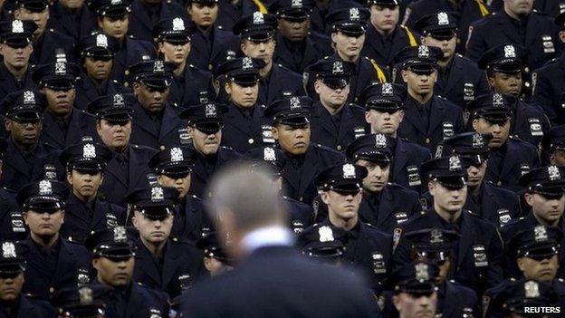 New York Mayor Bill de Blasio speaks from the podium to the New York City Police Academy Graduating class in New York December 29, 2014