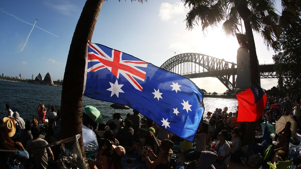 People gather along Sydney Harbour to welcome in the New Year on New Year's Eve on Sydney Harbour on 31 December 2014 in Sydney, Australia.