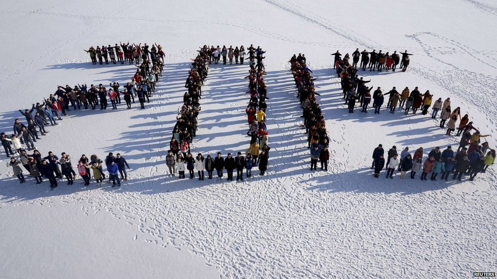 "Students form ""2015"" standing on snow to welcome the upcoming New Year at Shenyang Agriculture University in Shenyang, Liaoning province, 31 December 2014."