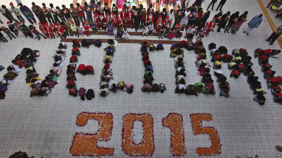 Indian students form numbers representing the year 2015 during a function to welcome the New Year at a school in Ahmadabad, India, on 31 December 2014
