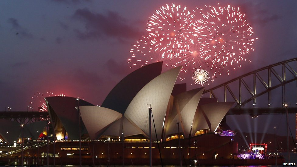 Fireworks light up the Sydney Opera House during an early light show before the new year on 31 December 2014