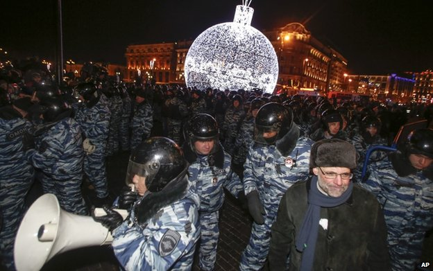 Police prepare to push supporters of Russian opposition activist and anti-corruption crusader Alexei Navalny away during an unsanctioned protest in Moscow, Russia, 30 December 2014