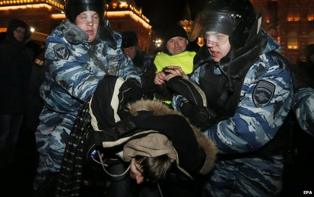 Policemen detain a supporter of opposition leader Alexei Navalny during rally central Moscow, Russia, 30 December 2014