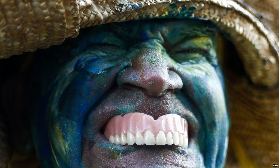 A man with his face painted before the 90th Sao Silvestre international 15km race in Sao Paulo, Brazil, on 31 December 2014