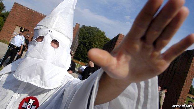 A Klu Klux Klan member salutes in Tennessee.