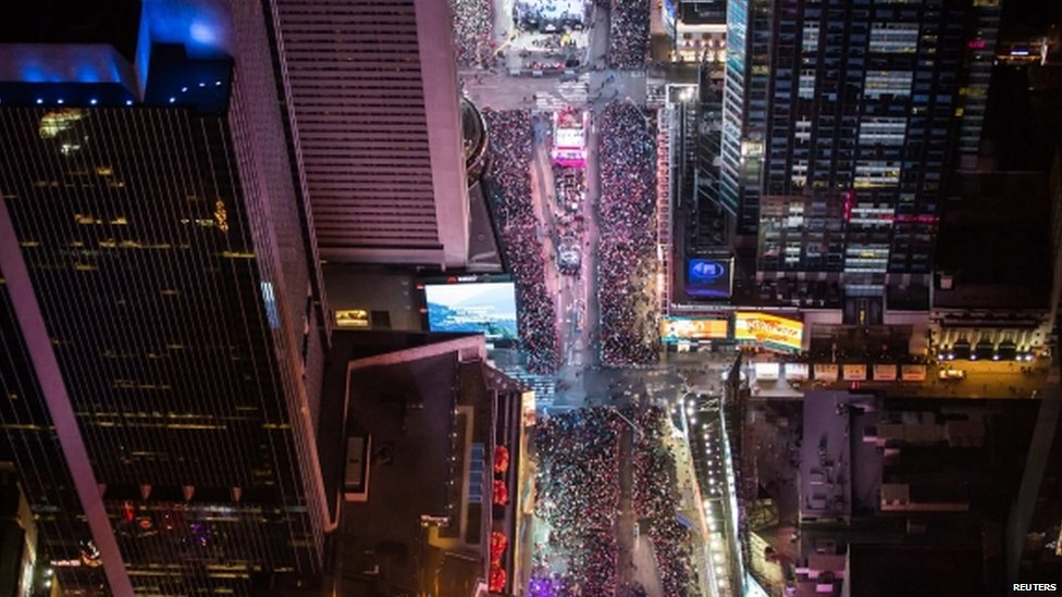 "In this aerial image over Midtown, Manhattan, revellers are seen taking part in New Year""s Eve celebrations in Times Square (01 January 2015)"