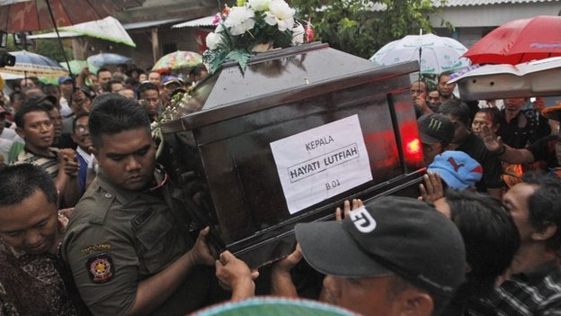 The funeral of Air Asia crash victim, Hayati Lutfiah Hamid, Surabaya, east Java, 1 January 2015