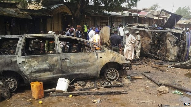 A general view of the scene of a bomb blast at Dukku bus rank in Gombe, Nigeria, 22 December 2014