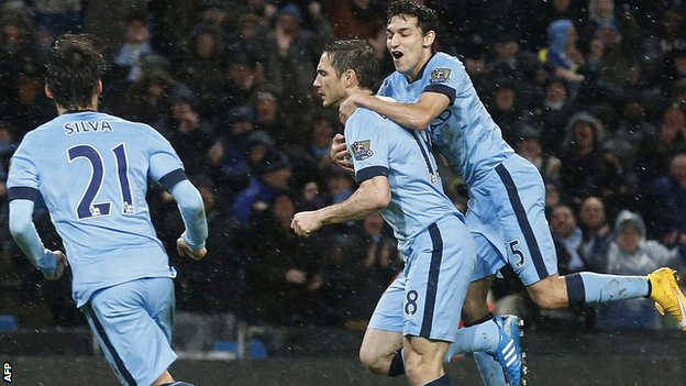 Frank Lampard is congratulated by his Manchester City team-mates after scoring the winner against Sunderland