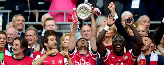 Arsenal lift the FA Cup after beating Hull in last season's final