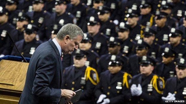 New York Mayor Bill de Blasio addresses new police academy graduates.