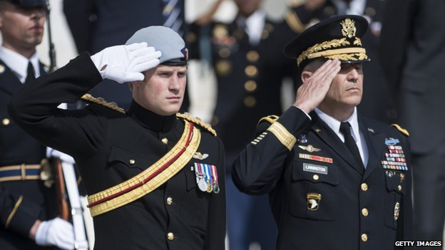 Prince Harry and Major General Michael S Linnington saluting