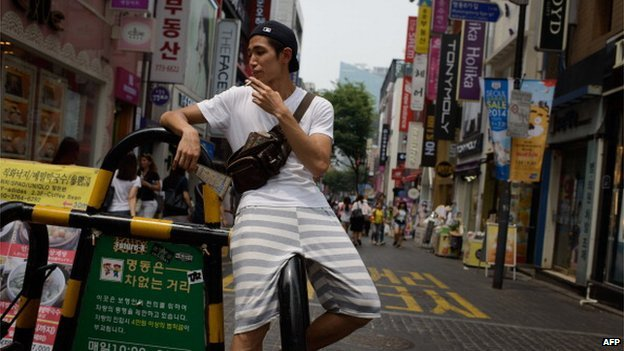 A man smoking in the street in Seoul