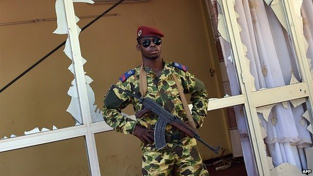 A Burkinabe soldier stands guard outside the national television headquarters after gunshots were fired around the premises in Ouagadougou on 2 November 2014