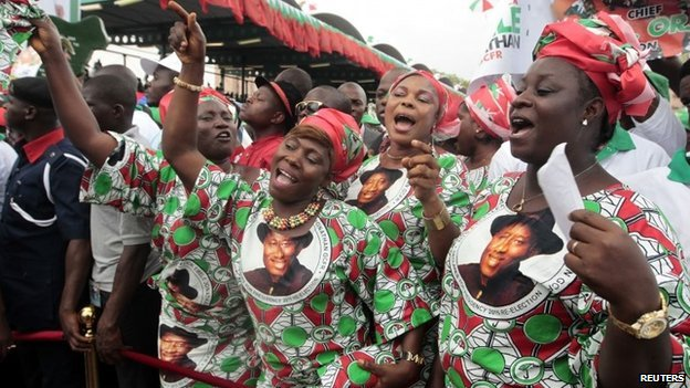 Supporters of Nigeria's President Goodluck Jonathan react during his declaration to seeking a second term in the February 2015 presidential election, in Abuja on 11 November 2014