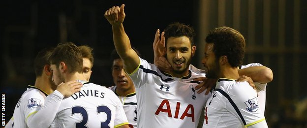 Nacer Chadli (second from right) celebrates