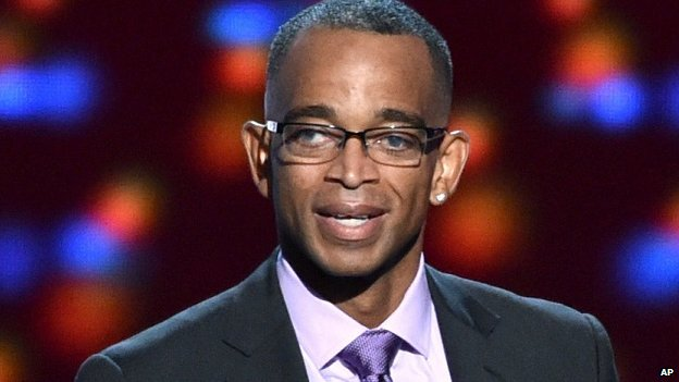 ESPN presenter Stuart Scott accepts a ESPY perseverance award in 2014.