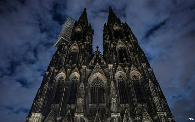 The lights of the Cologne Cathedral are switched off in protest at right-wing initiative Pegida (Patriotic Europeans against the Islamisation of the Occident) in Cologne, Germany, 5 January 2015