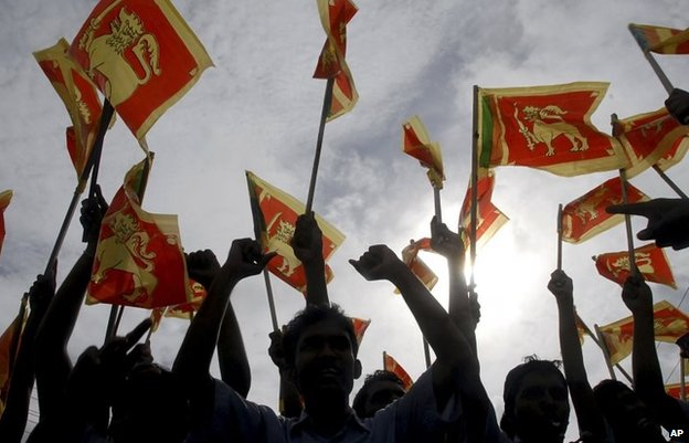 In this 22 May 2009 file photo, Sri Lankans wave their national flag during a victory rally to celebrate the defeat of the Tamil Tiger rebels, in Colombo