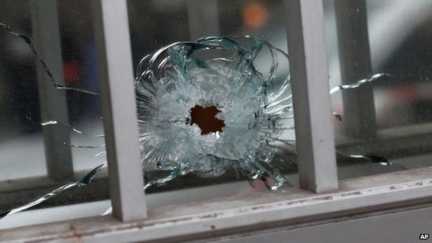 A bullet hole in a building near the Charlie Hebdo offices