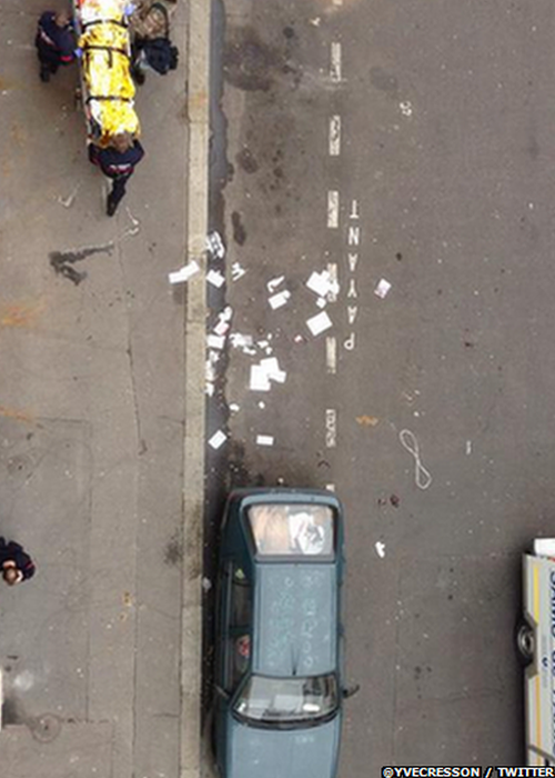 "This image was tweeted with the text: ""A second seriously injured person is taken out #CharlieHebdo"""