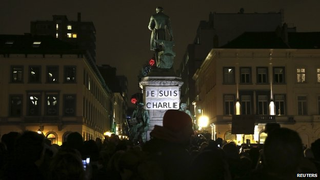 "A placard which reads ""I am Charlie"" is pictured as people gather to pay tribute to the victims of a shooting by gunmen at the offices of weekly satirical magazine Charlie Hebdo in Paris, in front of the European Parliament in Brussels January 7, 2015"