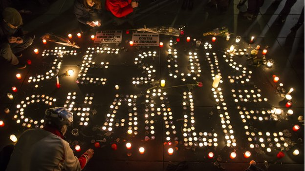 Candle light vigil in central Paris