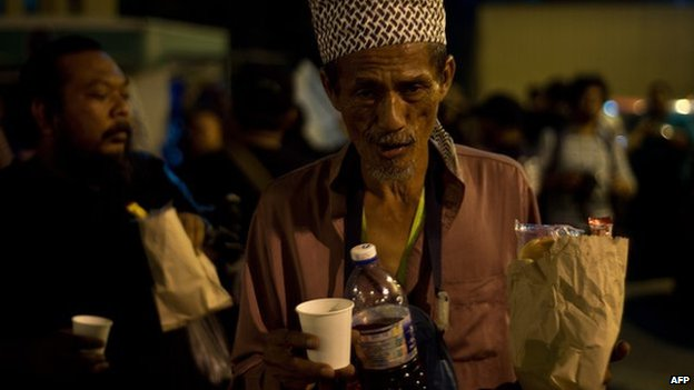 A homeless man at a soup kitchen