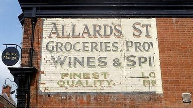 The signs, such as this one in Leicester, were phased out after billboard technology was developed in the 1960s